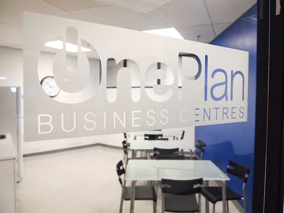 OnePlan logo etched on glass kitchen wall